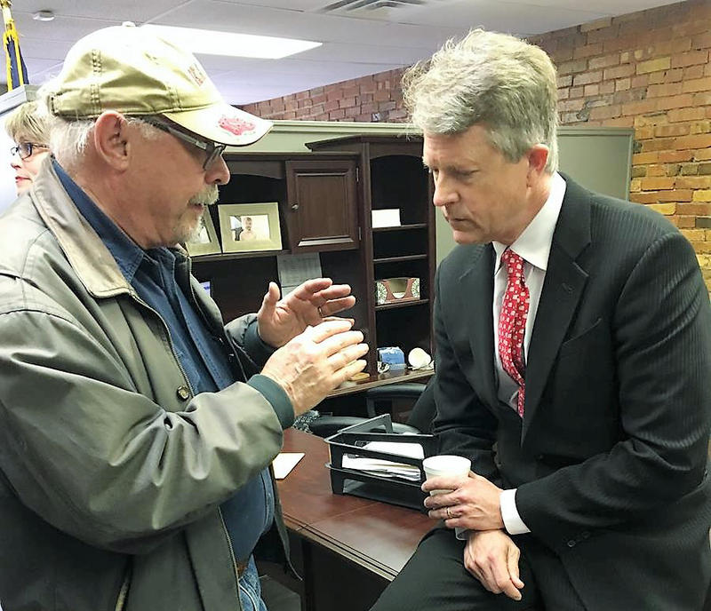 Congressman Roger Marshall talks with a constituent at the opening of his district office.