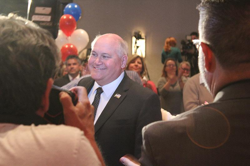 Ron Estes walks toward the stage to give his victory speech Tuesday.
