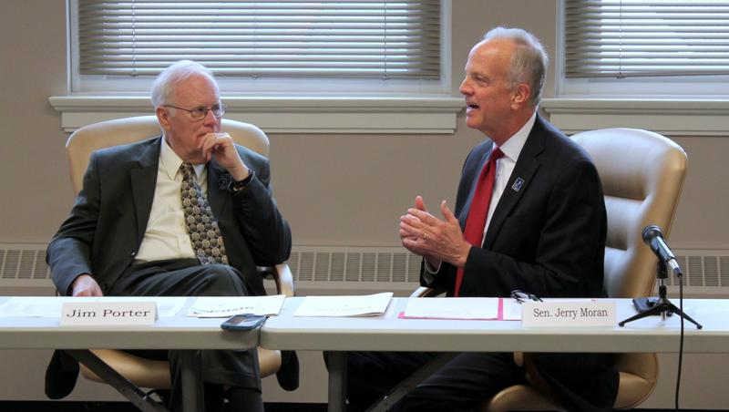 Sen. Jerry Moran speaks while Board of Education Chairman Jim Porter listens at a meeting this weekend.