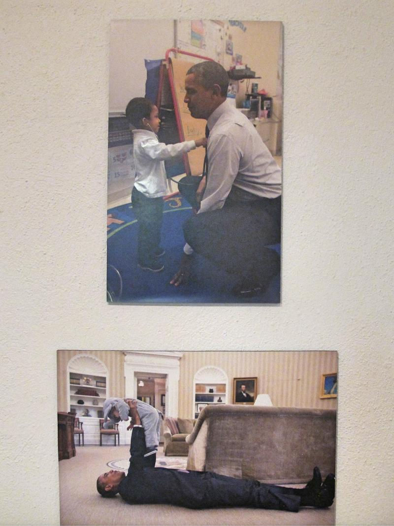 A display showing President Obama interacting with children.