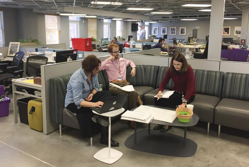 Eagle reporters collaborate in an open space at the new location.