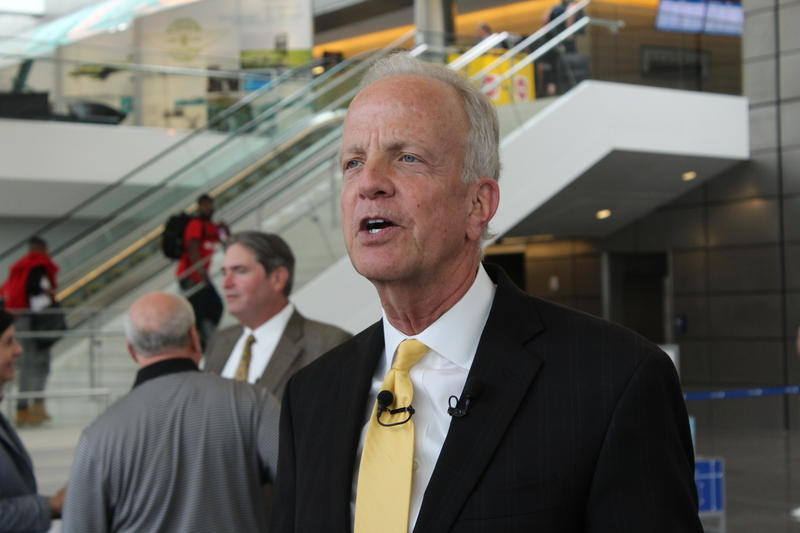 Sen. Jerry Moran speaks to reporters during a visit to Wichita's Eisenhower National Airport. He reiterated his opposition to a proposal to privatize air traffic control operations.