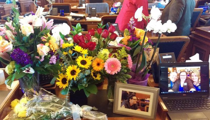 Representative Terrell's desk covered in flowers.