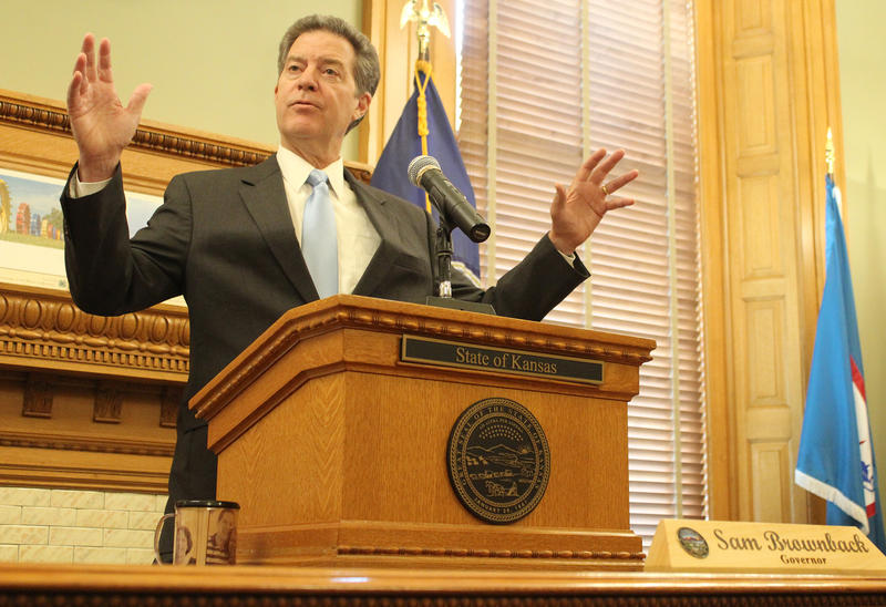 Gov. Sam Brownback discusses his signature tax policy and other key issues during his years as governor during a news conference Thursday at the Statehouse.