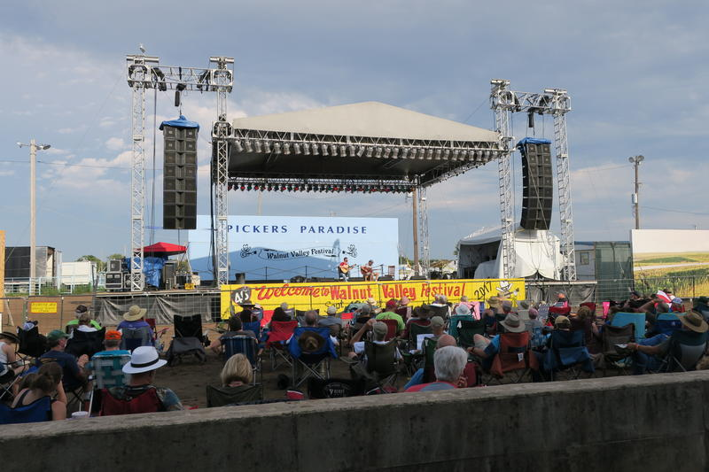 Winners of the National Flat Pick Style Guitar Championship perform on Stage 1 at the Walnut Valley Festival in Winfield, KS.