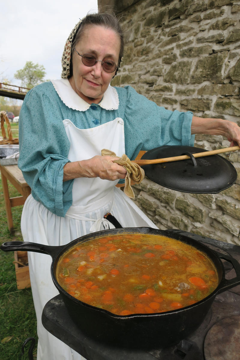 Ellen Sillette, from near Olathe, cooks a beef stew on a potbelly stove from the 1800s.