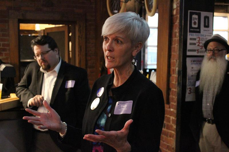 District 6 candidate Cindy Claycomb speaks to the Young Professionals of Wichita group during a meet-and-greet at an Old Town bar. District 3 candidates James Clendenin and William Stofer listen.