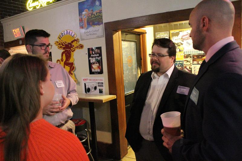 Members of Young Professionals of Wichita speak to District 3 candidate James Clendenin during an event Tuesday night at a bar in Old Town.