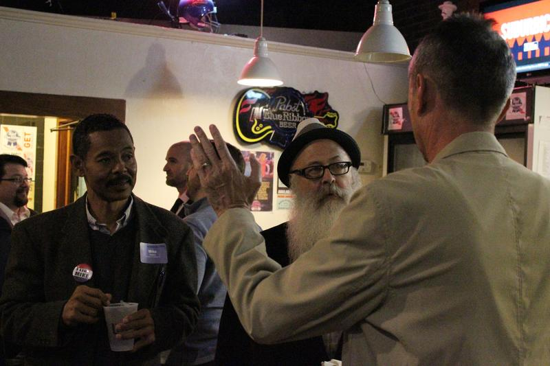 District 1 candidate Mike Kinard and District 3 candidate William Stofer speak with an attendee at Tuesday's meet-and-greet.