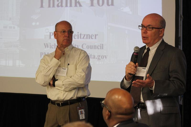 Wichita City Councilman Pete Meitzner, left, listens as Newton Mayor Barth Hague speaks Wednesday at the Midwest Interstate Passenger Rail Conference in Wichita.