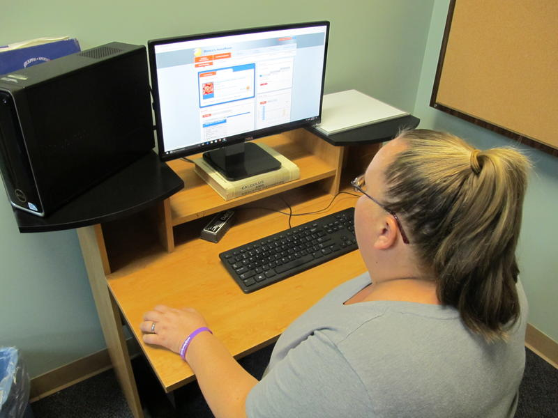 Monica works on a computer for school as a participant in the Wichita Women's Initiative Network (WIN) program.