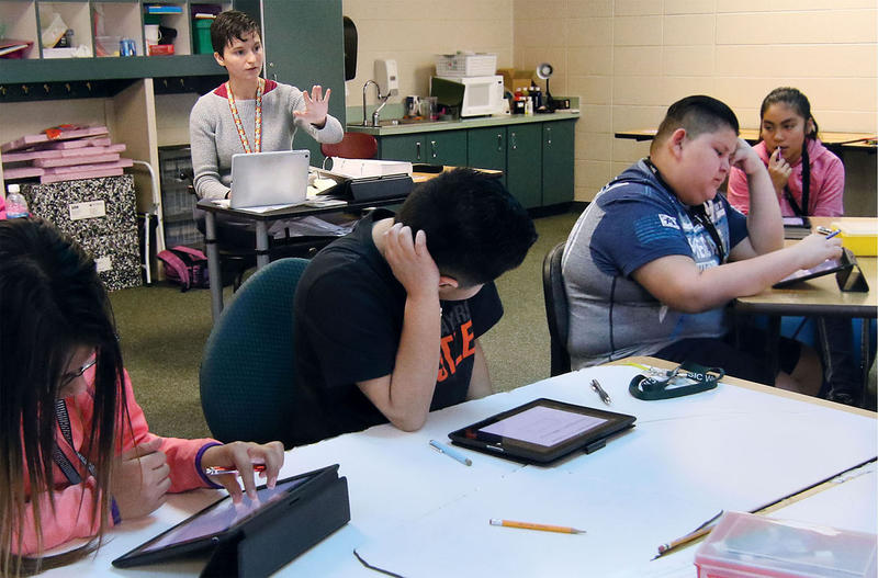 Charles O. Stones Intermediate Center teacher Sarah Drubinskiy teaches her students about multiplying fractions on in April 2017 at the school in Garden City USD 457.