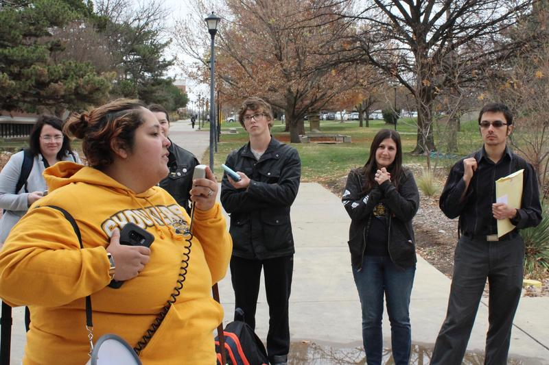Deborah Ojeda-Leitner, a graduate student at WSU, speaks at a rally against the Republican tax reform efforts.