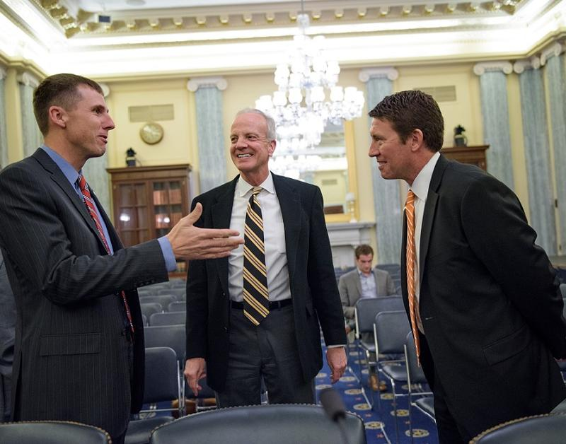 From left to right: Justin Knopf, vice president of Kansas Association of Wheat Growers, U.S. Sen. Jerry Moran (R-Kan.) and Jason Tatge, co-founder and CEO of Farmobile.