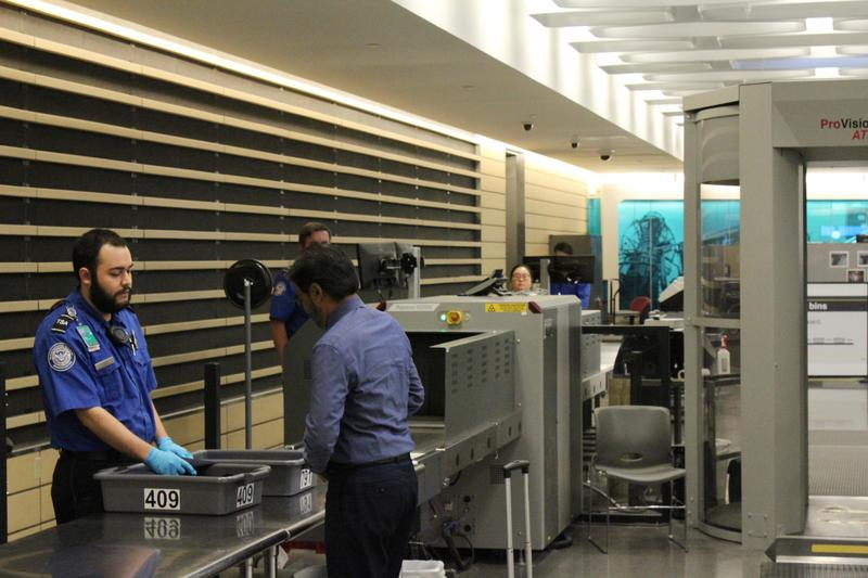 A traveler goes through the TSA security check at Wichita Dwight D. Eisenhower National Airport.