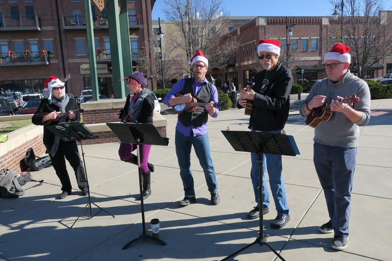 Ukuleleists Bob Colladay, Rob Loren, Ryan McGinnis Shannon Littlejohn, and Marta McKim give their take on Christmas carols on Saturday in Old Town Square.
