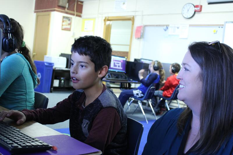 Teacher Jamie Schaper instructs a student during an Hour of Code event Thursday at McLean Elementary.