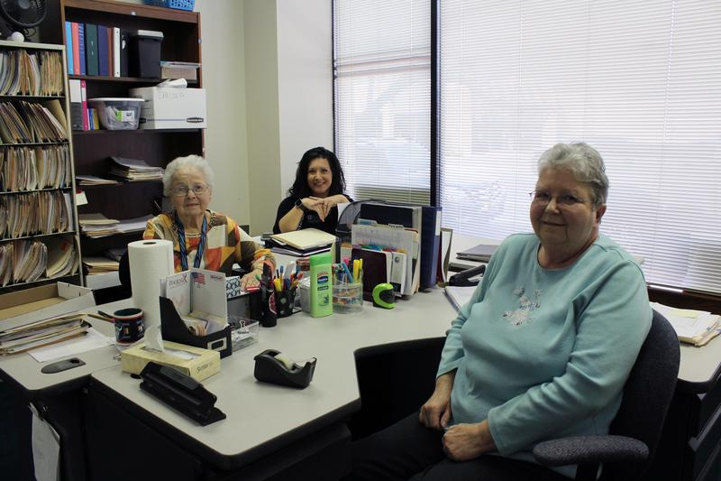 Volunteer nurse Mary Burke, executive director Chelsea French, and nurse manager Doris Allen sit in an office at Mayflower Clinic's new location in downtown Wichita.
