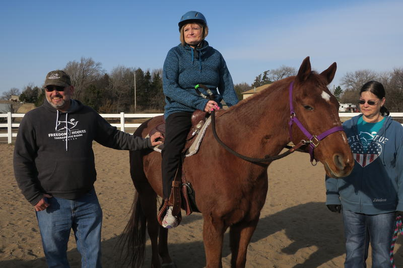 Volunteer Ronnie Price (L), rider Becky Johnson and volunteer Kim Andrews (R) wait for next exercise.