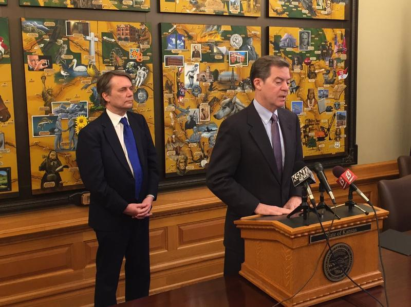Gov. Sam Brownback, right, and Lt. Jeff Colyer say they've stopped plans for KanCare 2.0, but will continue to call for work requirements and an extension of private management of Medicaid.