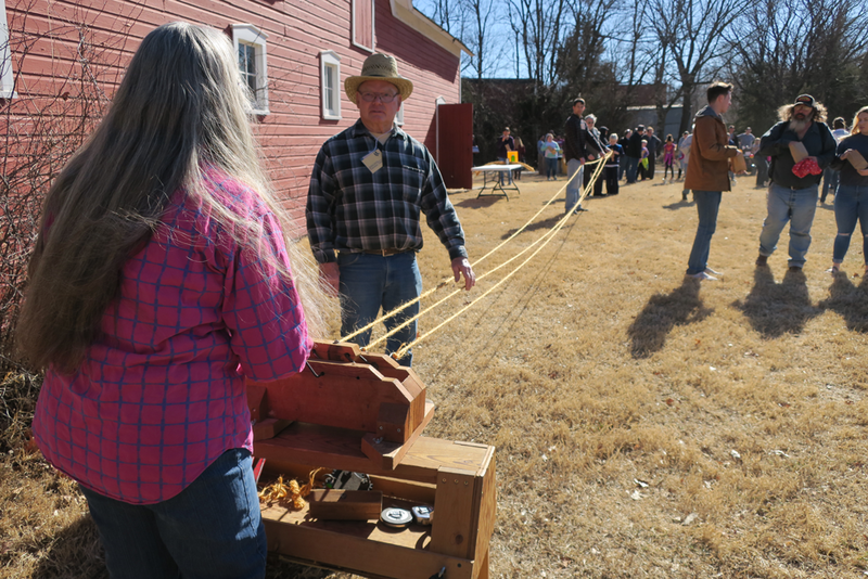 Gordon Unruh shows how twine is spun into rope at the Kansas Day Celebration at Kauffman Museum in North Newton.