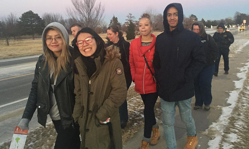 WSU sophomore Sarah Myose, center, joins other marchers in the middle of the MLK Unity Walk.