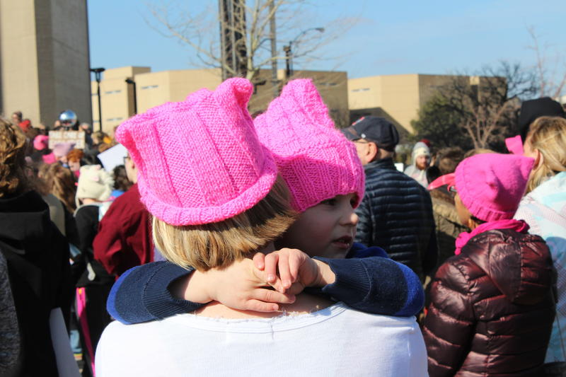 Like last year, pink hats were a common site at Saturday's rally.