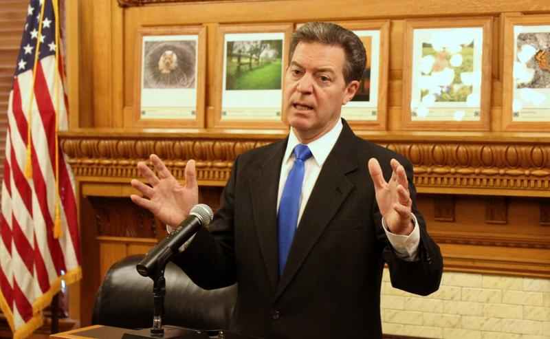 Brownback speaks at an event in 2016.