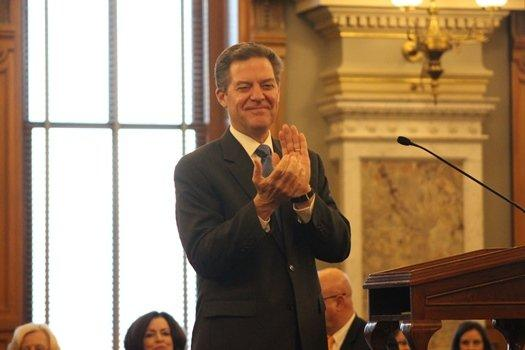Kansas Gov. Sam Brownback applauds during his 2018 State of the State address at the Statehouse Tuesday.