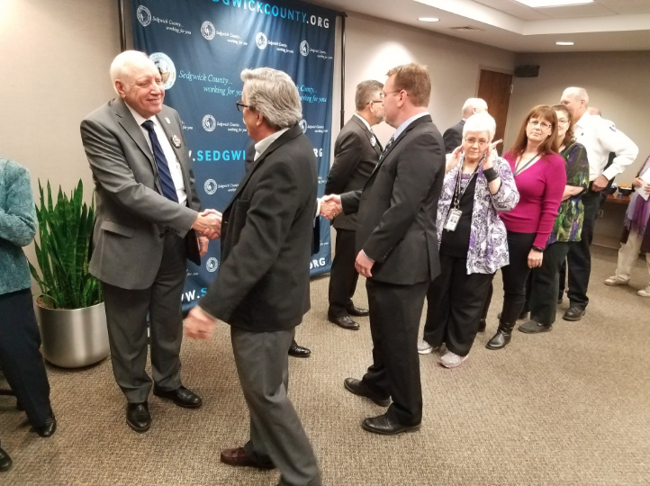 New county commission Chairman David Dennis is congratulated at a ceremony Wednesday.