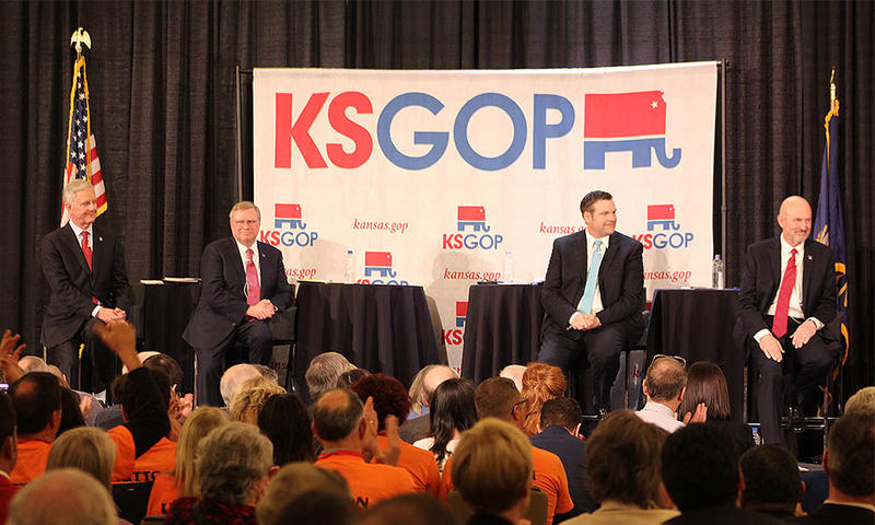 Republican candidates for governor Wink Hartman, Mark Hutton, Secretary of State Kris Kobach and Insurance Commissioner Ken Selzer on stage at the first debate Saturday.