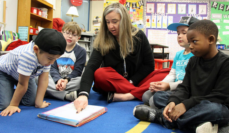 First-grade teacher Shauna Hammett focuses on phonics with her students, deploying a method that's backed by research — something state rules will soon demand.