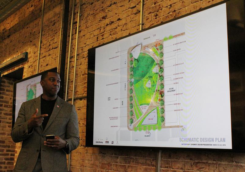 City Council member Brandon Johnson stands in front of the latest design for Naftzger Park during a public meeting this week.
