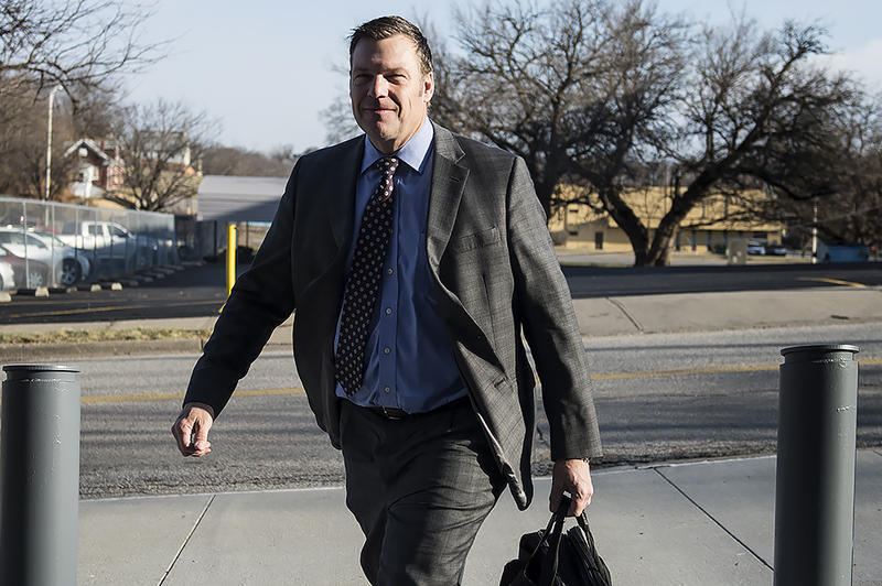Kansas Secretary of State Kris Kobach arrives at the federal courthouse in Kansas City, Kansas, on Tuesday for the last of some grueling days testing the state's voter registration rules.