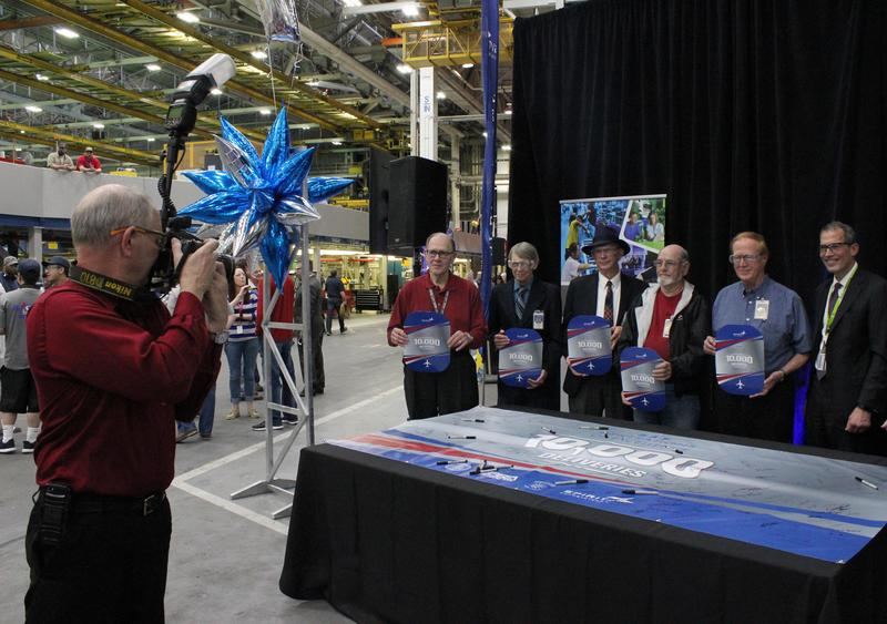 John Fuller, second from right, and other longtime Spirit employees were honored at the celebration. Fuller has worked for Spirit for 59 years.