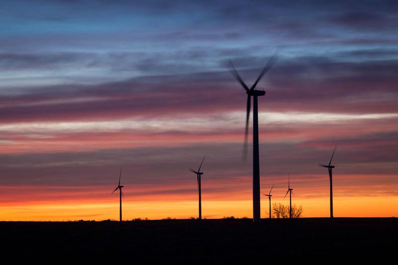 Wind blows through a wind farm off of I-70 near Hays, Kansas.