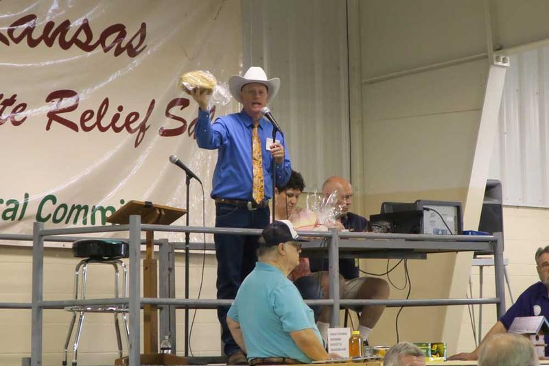 Auctioneer Van Schmidt looks for bids on a loaf of bread to open the General Auction. It sold for $200 on Friday night. Saturday morning the loaf sold for $600.