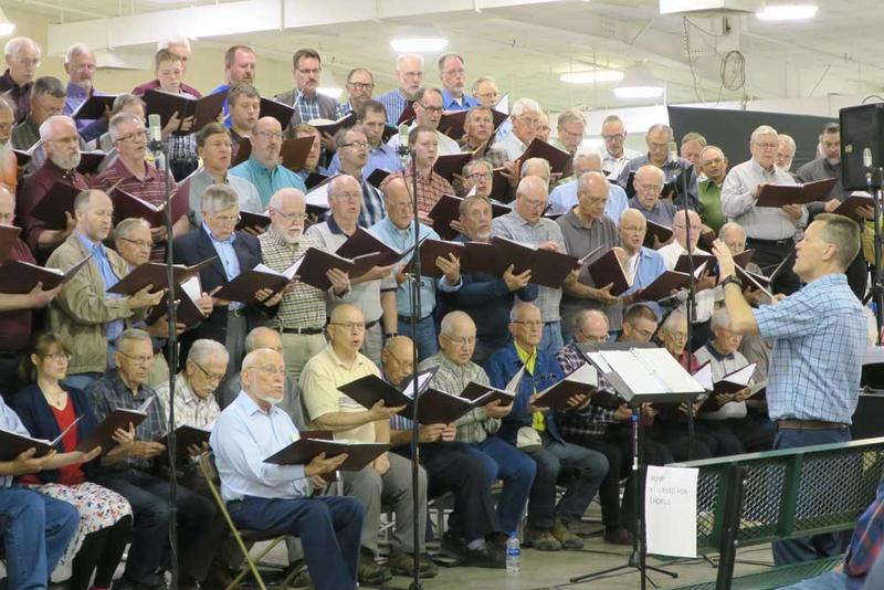 The Kansas Mennonite Men's Chorus performs a concert at the Kansas Mennonite Relief Sale. Greg Bontrager is the director.