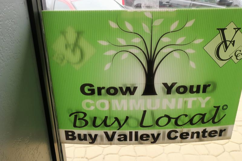 Signs to support local businesses are spread throughout downtown Valley Center.