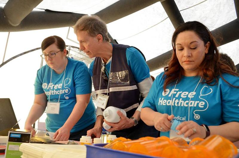 Pharmacy volunteers Melissa Rodriguez, Jim Garrelts and Jessica Telles work at last year's Day of Free Health Care.