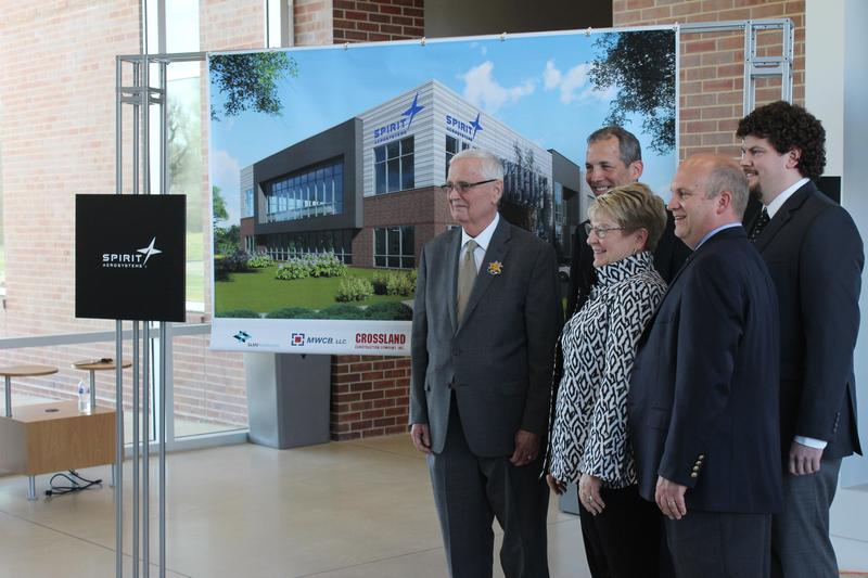 WSU President John Bardo, Spirit CEO Tom Gentile, WSU Tech President Sheree Utash, John Tomblin of WSU and former student Trevor Steinbeck stand next to a rendering of the WSU-Spirit building.
