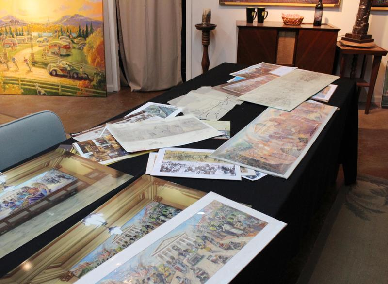 Renderings of the Brown v. Board of Education mural are scattered on a table in Michael Young's studio.