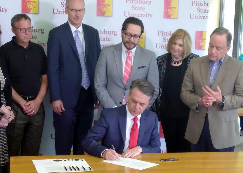 Kansas Gov. Jeff Colyer signs a copy of the budget at Pittsburg State University. He also signed copies at Emporia State and Kansas State Tuesday to tout a restoration of some higher education funding.