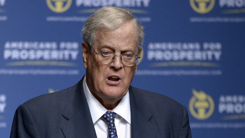 David Koch, seen here speaking at a 2013 event in Orlando, is stepping down from his duties at Koch Industries, according to his brother Charles Koch.