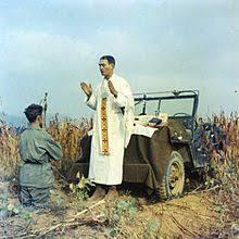 Father Emil Kapaun celebrates Mass on the hood of a jeep during the Korean War. Kapaun died in a North Korean POW camp and his remains have not been recovered.