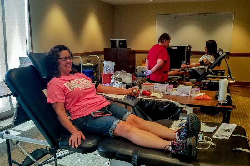 Karen Alderson gives blood Tuesday during an American Red Cross blood drive at Friends University.
