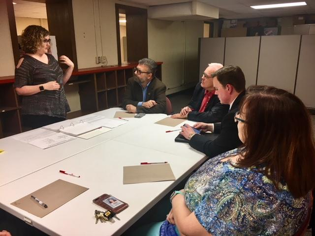 Election commissioner Tabitha Lehman, left, talks with County Commissioners Jim Howell, Dave Unruh and Michael O'Donnell, and Karen Bailey, a proxy for Richard Ranzau, during Friday's Board of Canvassers meeting.