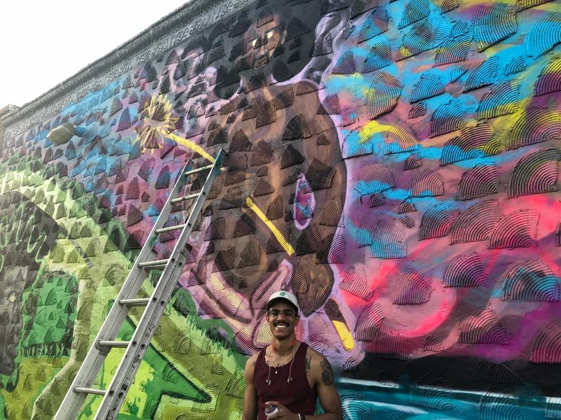 "Artist Juanta Wolfe says he told Horizontes Project organizers ""I'll give it all I've got"" in spray painting the mural."
