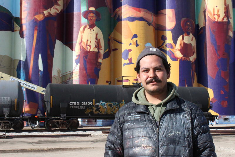 Armando Minjarez, director and curator of the Horizontes project, stands in front of the mural. Minjarez said he'd dreamed of painting a grain elevator years before it became a reality.