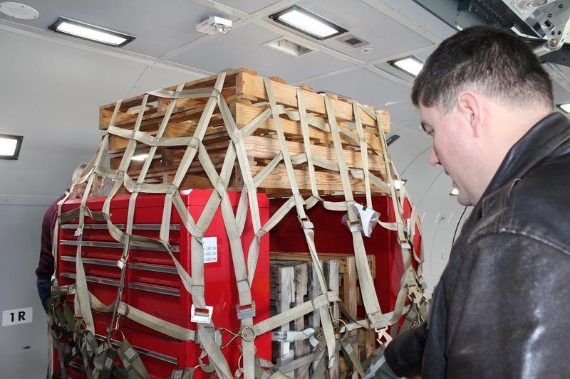 349th Air Refueling Squadron Superintendent Bartek Bachleda inspects a cargo load during an introduction to the KC-46 fuselage trainer.